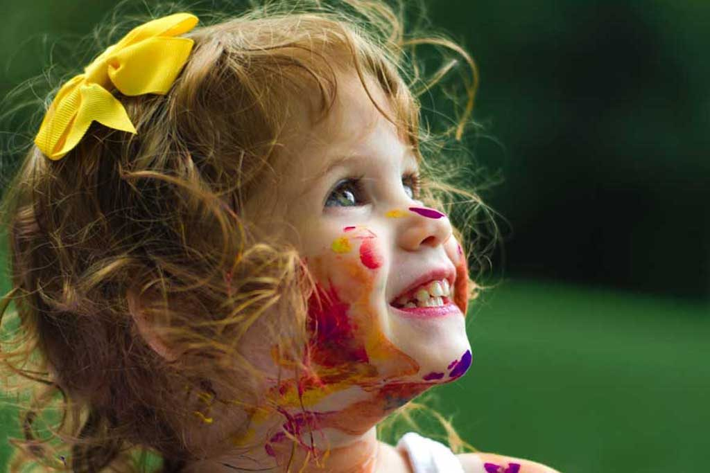 a girl with a painted face